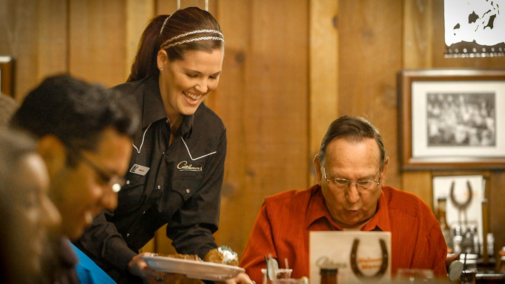Cattlemens server, serving guest