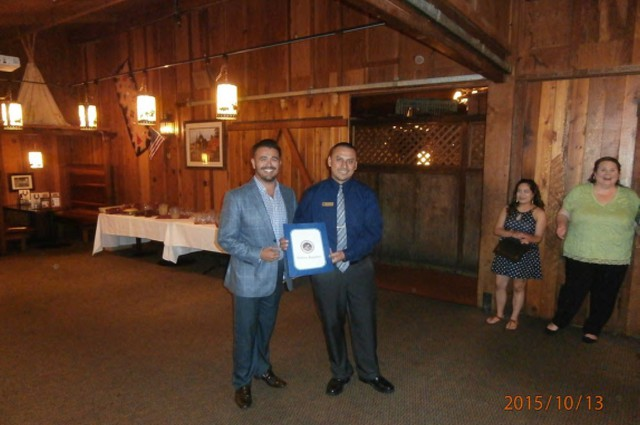 Manager of Cattlemens receiving certificate of recognition