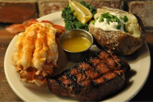 Steak and Lobster with baked potato