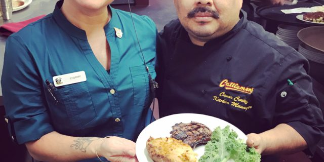 Two managers serving Steak at the Cattlemens in Dixon
