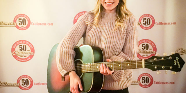 Musician Dallas Caroline sings at Cattlemens 50th Anniversary Celebration.