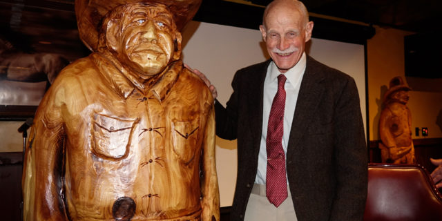 Pete Jr. Co-Founder Cattlemens with a wooden cowboy in his honor.
